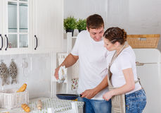 Happy pregnant family in the kitchen. Royalty Free Stock Photography
