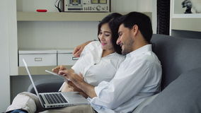 Happy pregnant family with laptop stock video