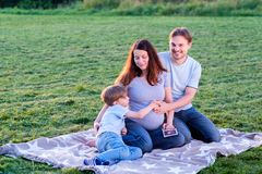 Happy pregnant family of three expecting new baby Stock Images