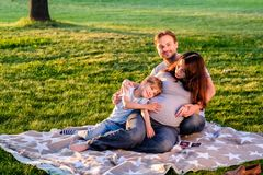 Happy pregnant family of three expecting new baby Stock Photo