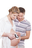 Happy pregnant family with ultrasound picture Stock Photo