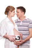 Happy pregnant family with ultrasound picture Stock Photos