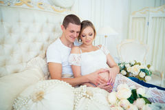 Happy pregnant family waiting for baby. Stock Image