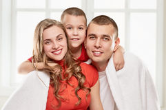Happy pregnant family. Pregnant women with her husband and son at home Stock Images