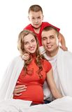 Happy pregnant family. Pregnant women with her husband and son on white Stock Photography