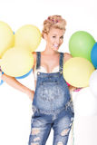 Happy pregnant girl with balloons. Royalty Free Stock Photos