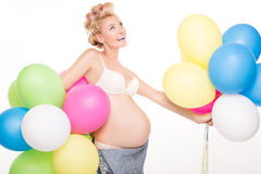 Happy pregnant girl with balloons. Royalty Free Stock Photo