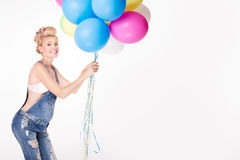 Happy pregnant girl with balloons. Stock Photography