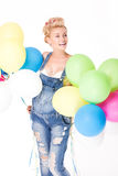 Happy pregnant girl with balloons. Stock Photos
