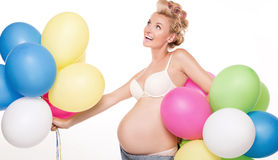Happy pregnant girl with balloons. Stock Photo