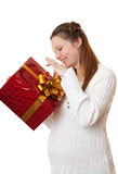Happy pregnant girl with gift. Stock Image