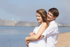 Happy pregnant girl and her loving husband Royalty Free Stock Images
