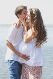 Happy pregnant girl and her loving husband Stock Photos