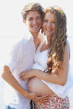 Happy pregnant girl and her loving husband Stock Photography