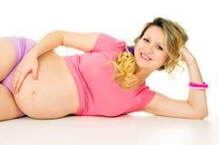 Happy Pregnant Girl Lying Stock Photo