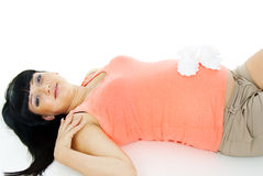 Happy pregnant girl lying with booties Stock Photography