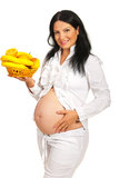 Happy pregnant holding fruits Royalty Free Stock Photos