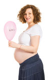 Happy pregnant holding pink balloon Stock Photos