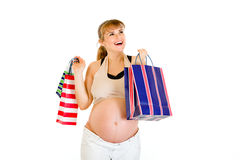 Happy pregnant holding shopping bags in hands Royalty Free Stock Image