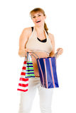 Happy pregnant holding shopping bags in hands Royalty Free Stock Photography