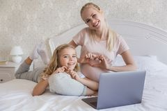 happy pregnant mother and daughter showing hearts stock photo