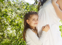 Happy pregnant mother and her little daughter Royalty Free Stock Photo