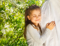 Happy pregnant mother and her little daughter. In the spring day Royalty Free Stock Images