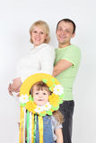 Happy pregnant wife and husband and little daughter Royalty Free Stock Photo