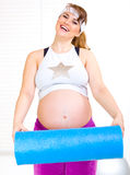 Happy Pregnant Woma With Exercise Mat Stock Image