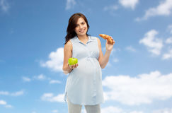 Happy pregnant woman with apple and croissant Royalty Free Stock Photography