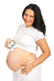 Happy pregnant woman with baby shoes Stock Images