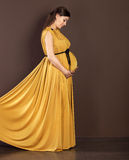 Happy pregnant woman in beautiful long dress Royalty Free Stock Image
