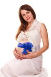 Happy pregnant woman with belly with blue bow Stock Photos