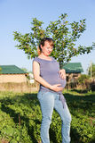 Happy pregnant woman with big belly on nature Royalty Free Stock Photos