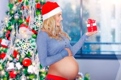 Happy pregnant woman in Christmas eve Stock Image