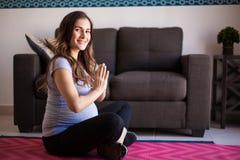 Happy pregnant woman doing yoga Royalty Free Stock Photos