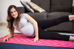 Happy pregnant woman exercising Stock Photography