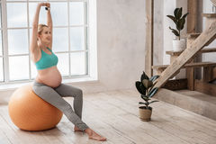 Happy pregnant woman exercising at home Royalty Free Stock Photos