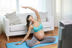 Happy pregnant woman exercising at home Royalty Free Stock Images