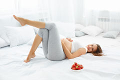 Happy Pregnant Woman Feels Healthy and Gets Some Fun. Healthy Fo Stock Image