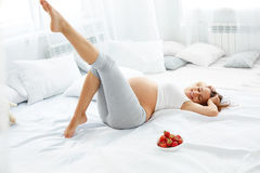 Happy Pregnant Woman Feels Healthy and Gets Some Fun. Healthy Fo Stock Images