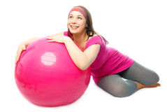 Happy pregnant woman with a fitness ball Stock Photo