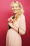Happy pregnant woman with gerber Stock Images