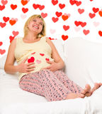 Happy pregnant woman with hearts Stock Photo