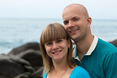 Happy pregnant woman and her husband on the coast. Royalty Free Stock Images