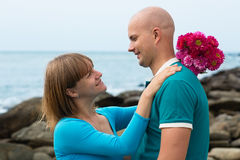 Happy pregnant woman and her husband on the coast. Royalty Free Stock Photos
