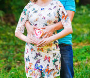 Happy pregnant woman and her husband Stock Images
