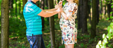 Happy pregnant woman and her husband Stock Photos