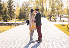 Happy pregnant woman and her husband in the park Royalty Free Stock Images