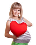 Happy pregnant woman hold red heart in hands stock image